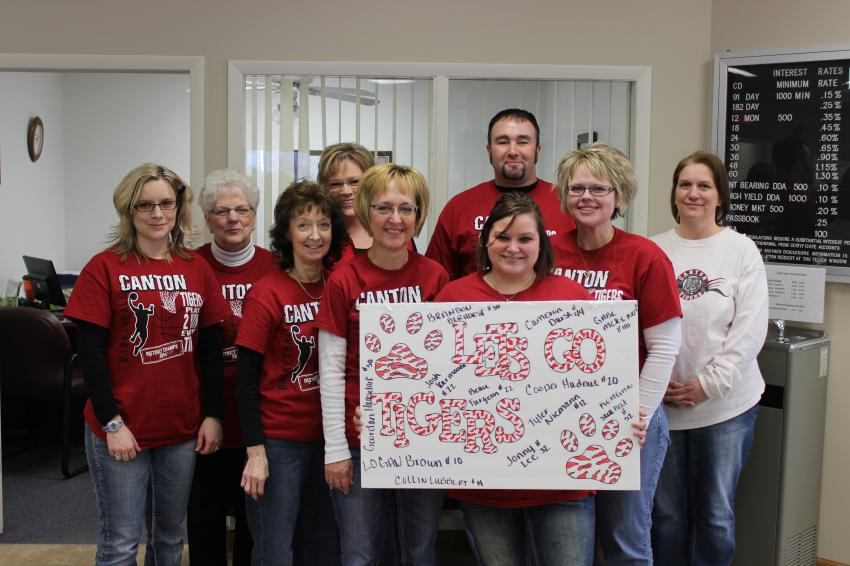 Bank Employees show their team spirit as the Canton Tigers Boys Basketball team competes in the State Tournament